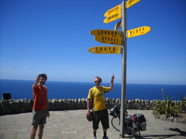 Guy and Steve at Cape Reinga and pointing to Cape Bluff
