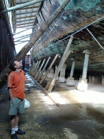 Guy looking at old timbers